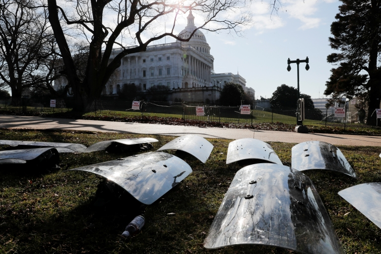 US National Guard riot shields are laid out at the ready outside the Capitol Building