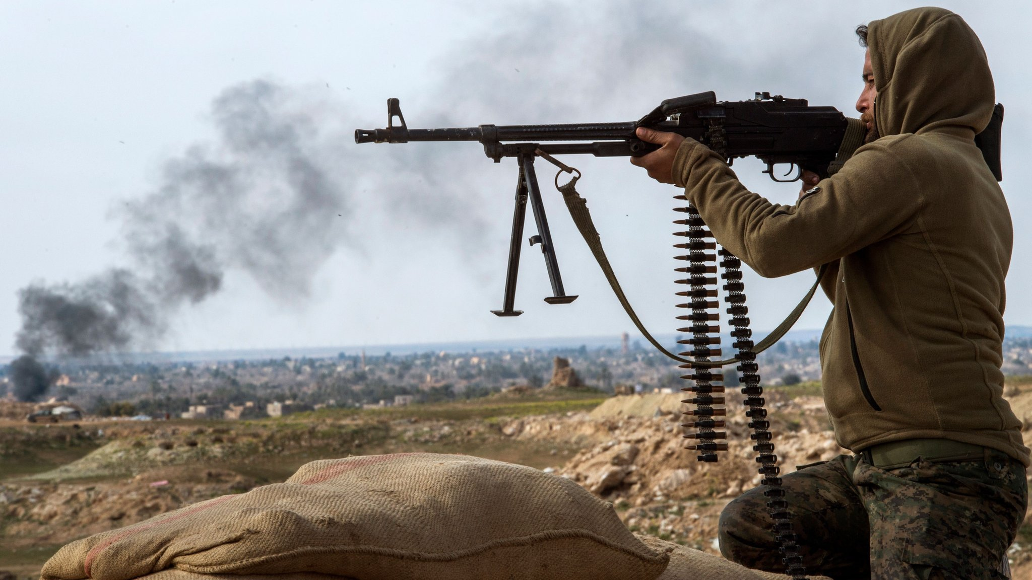 US-backed Syrian fighters battle to clear final two IS villages