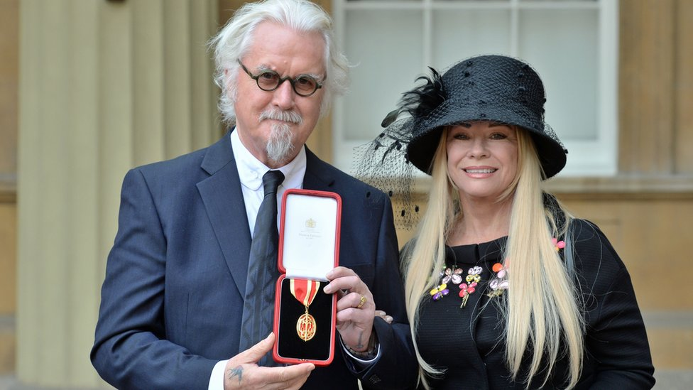 Billy Connolly receives knighthood at Buckingham Palace