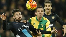 Olivier Giroud and Gary O'Neil compete for the ball