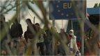 Migrants queuing