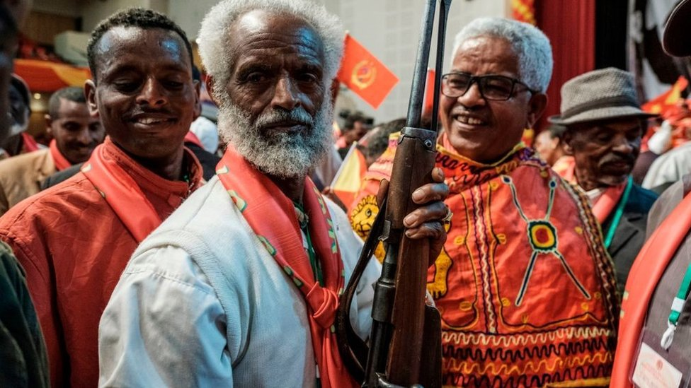 An attendee holds a rifle as people dance during the Tigray People's Liberation Front (TPLF) First Emergency General Congress in Mekelle, Ethiopia, on January 4, 2020