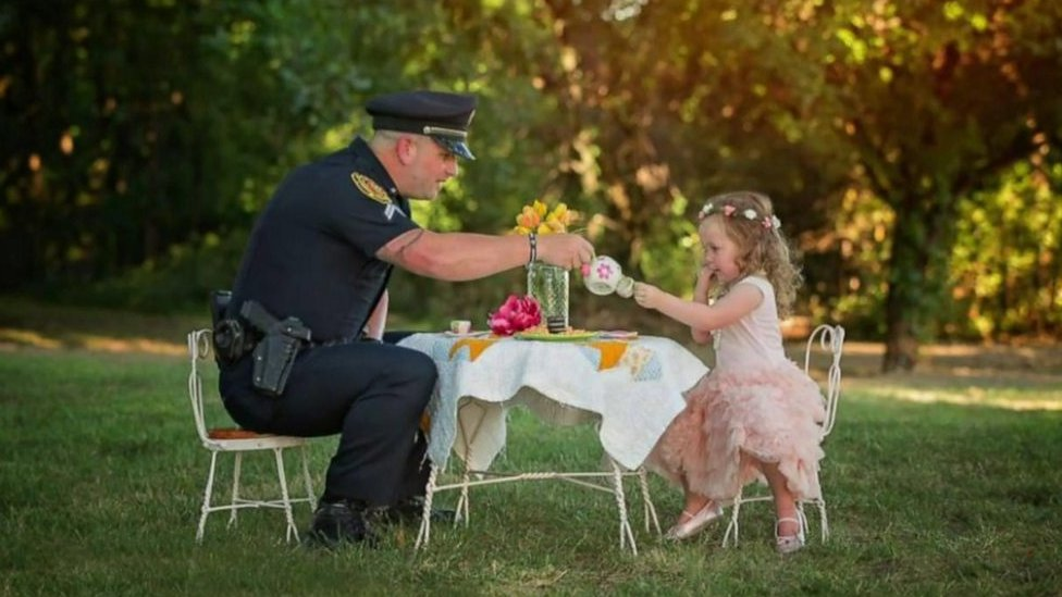 Little girl saved by Texas police officer throws him a tea party