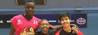 Muggsy Bogues (centre) with teenage players Femi and Ben