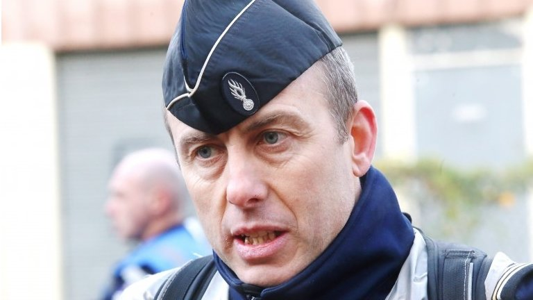 France shooting: Hostage swap officer 'fighting for life'