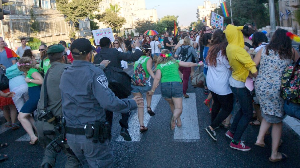 Six people are stabbed at a Gay Pride march in Jerusalem and police arrest an ultra-Orthodox Jewish man they say attacked marchers in 2005.