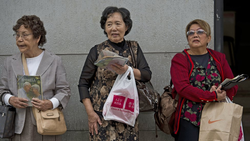 Women are seen at Liberdade, a central Sao Paulo neighbourhood with a high concentration of Japanese descendants, on June 14, 2014.