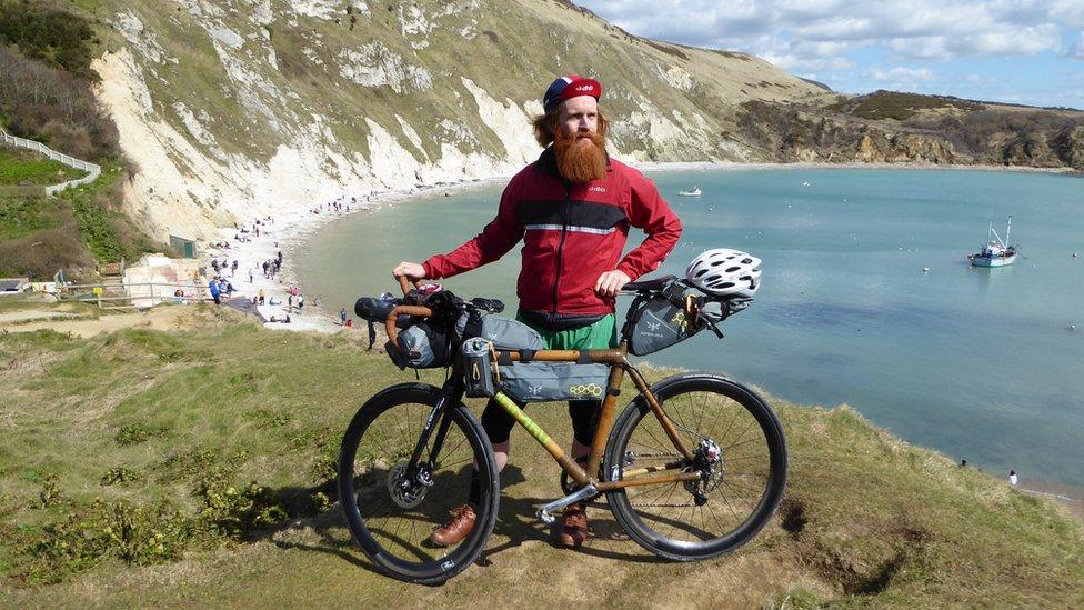 Adventurer Sean Conway completes 'GB coastline triathlon'