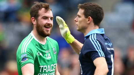 Sean Quigley smiles after Fermanagh's controversial first goal as Dublin keeper Stephen Cluxton protests