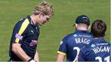 Jimmy Adams (left) with Glamorgan's Will Bragg and Michael Hogan (right)