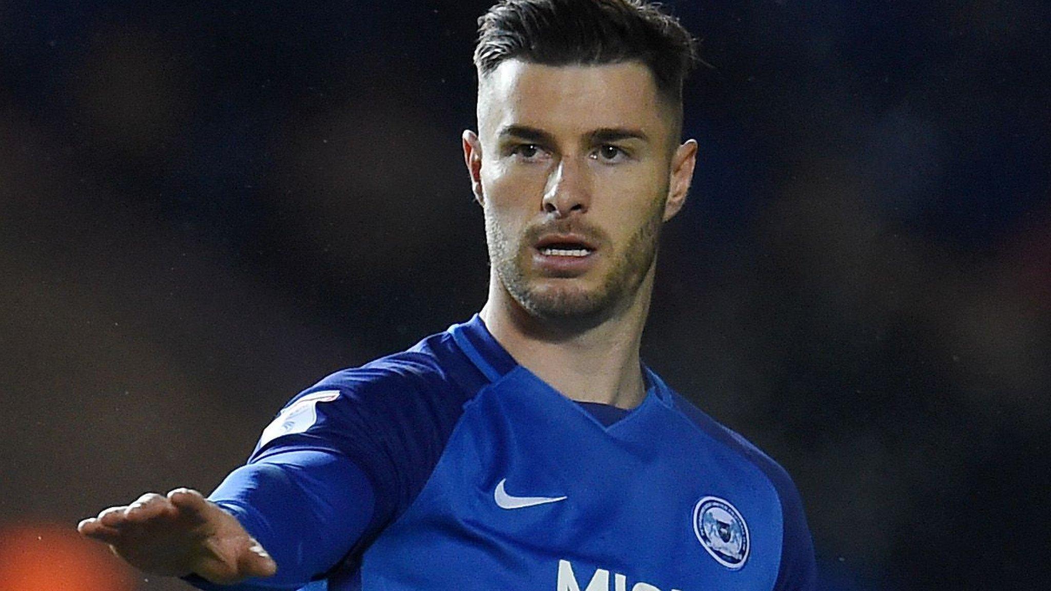 Andrew Hughes: Three Preston bids for Peterborough defender turned down