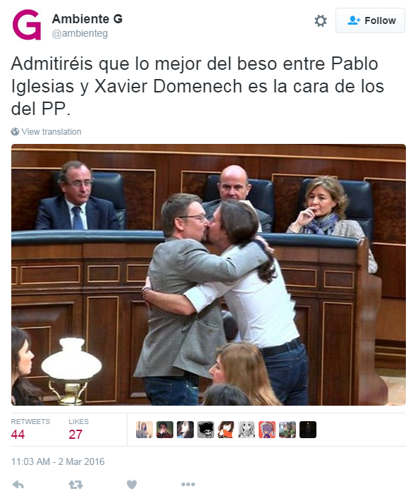 "Translation: ""You have to admit that the best part of this kiss between Pabloe Iglesias and Xavier Domenech is the looks on the faces of the PP"" - the politicians from the conservative Popular Party who are looking on"
