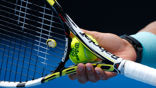 tennis player racket and ball