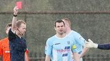 The referee shows the red card to Ballymena captain Jim Ervin