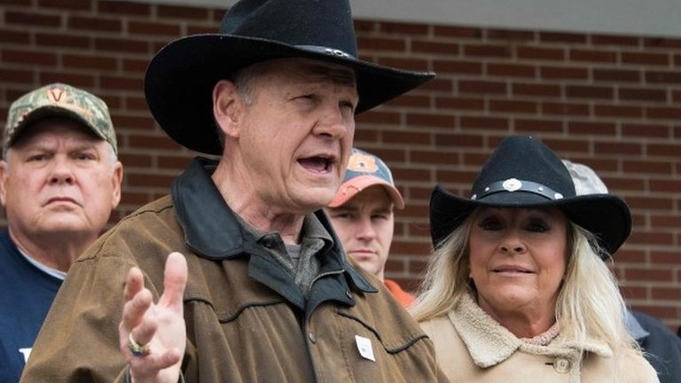 Roy Moore faces verdict of voters in Alabama Senate election