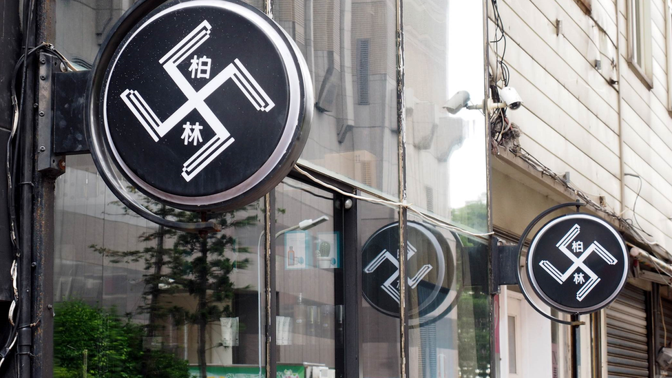 Taiwan hair salon covers 'swastika' signs after outcry
