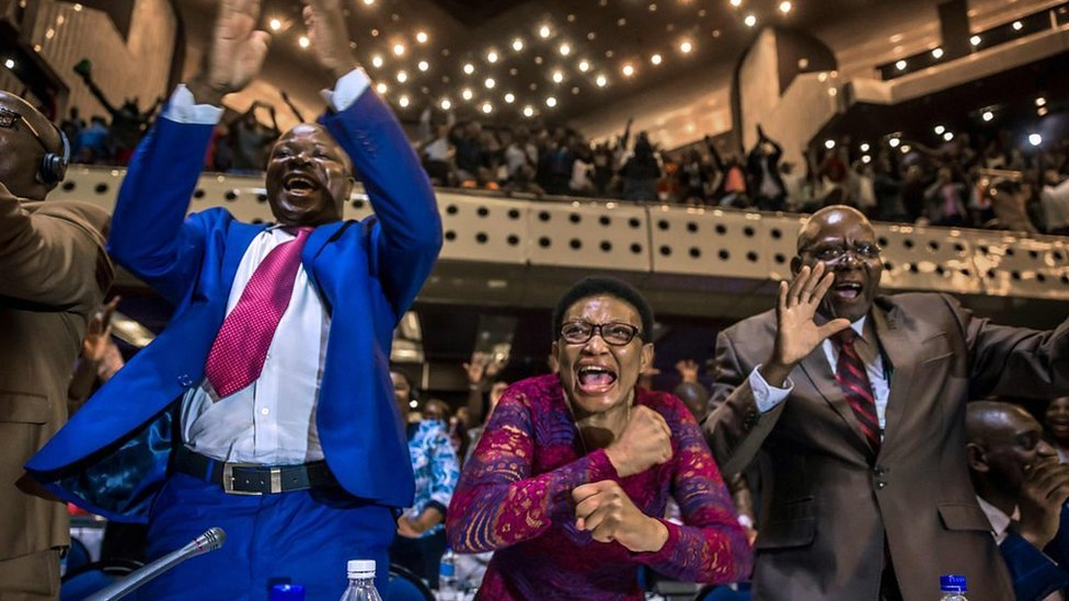 The moment Zimbabwean MPs hear Mugabe has resigned