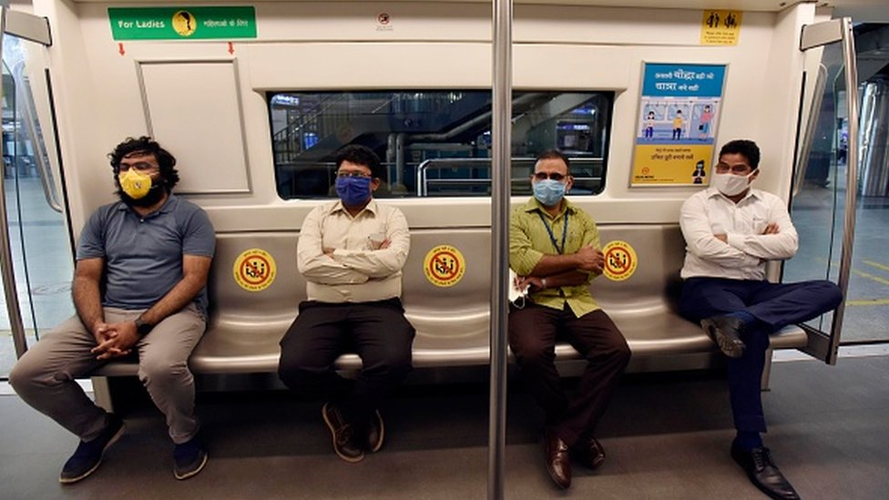 Passengers seated while maintaining social distancing in a metro coach during a press preview of Delhi Metro Rail Corporation (DMRC) preparedness ahead of metro services resuming on September 3, 2020