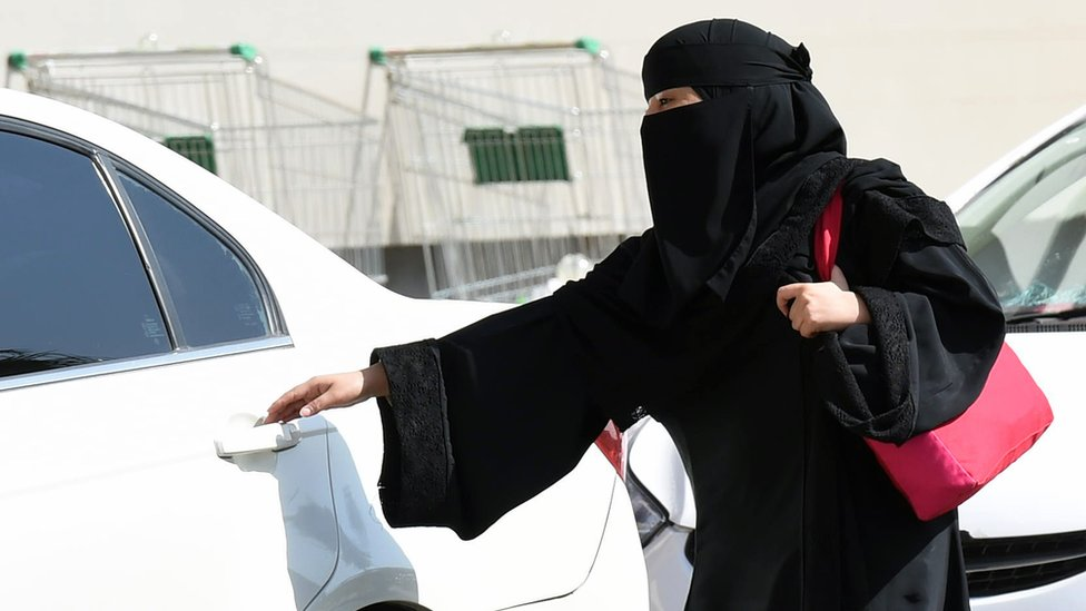 Woman from Saudi Arabia gets in car