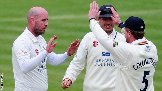 Chris Rushworth (left) celebrates a wicket for Durham