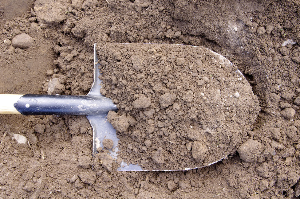 A shovel in mud