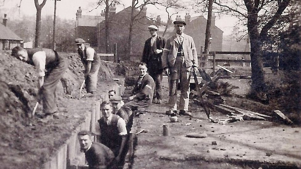 A group of men diverting Gallows Brook underground in 1919