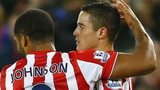 Glen Johnson and Ibrahim Afellay