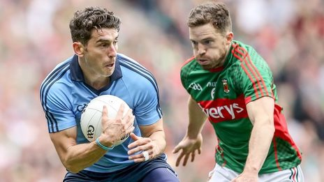 Dublin's Bernard Brogan is about to be challenged by Mayo's Chris Barrett at Croke Park