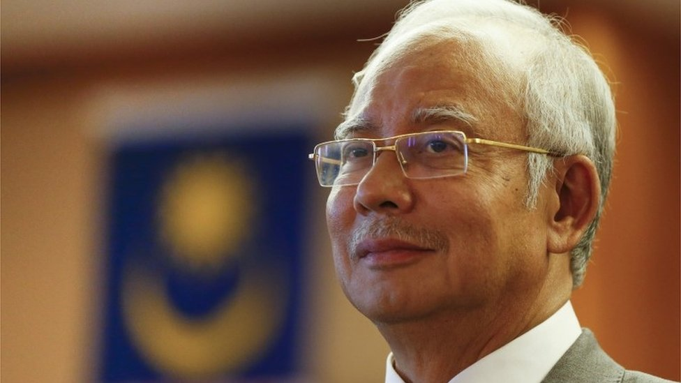 Malaysia's PM Najib Razak sacks his deputy prime minister and attorney general who had both criticised him over a financial scandal.