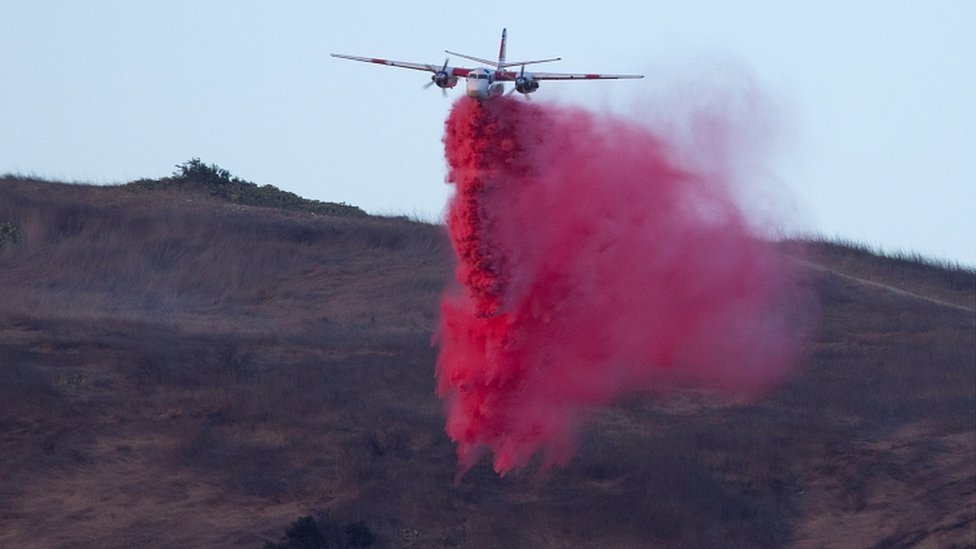A plane makes a retardant drop on the Silverado Fire burns near Lake Forest, California, U.S., October 26, 2020