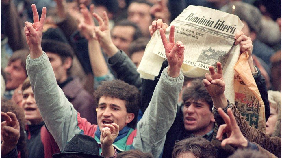 Romanians celebrate the fall of the Ceaucescu regime in December 1989