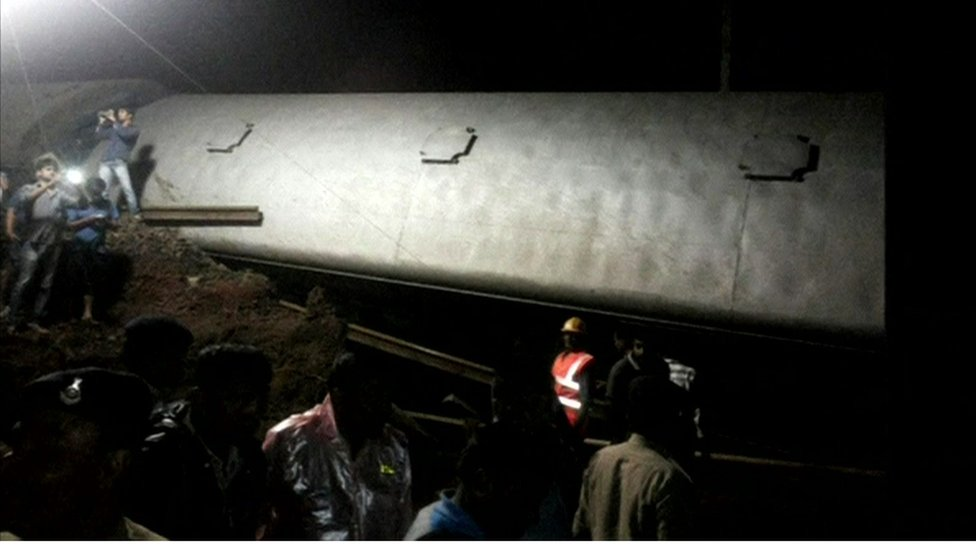 Two passenger trains in the Indian state of Madhya Pradesh derail within minutes of each other, killing at least 19 people, officials say.