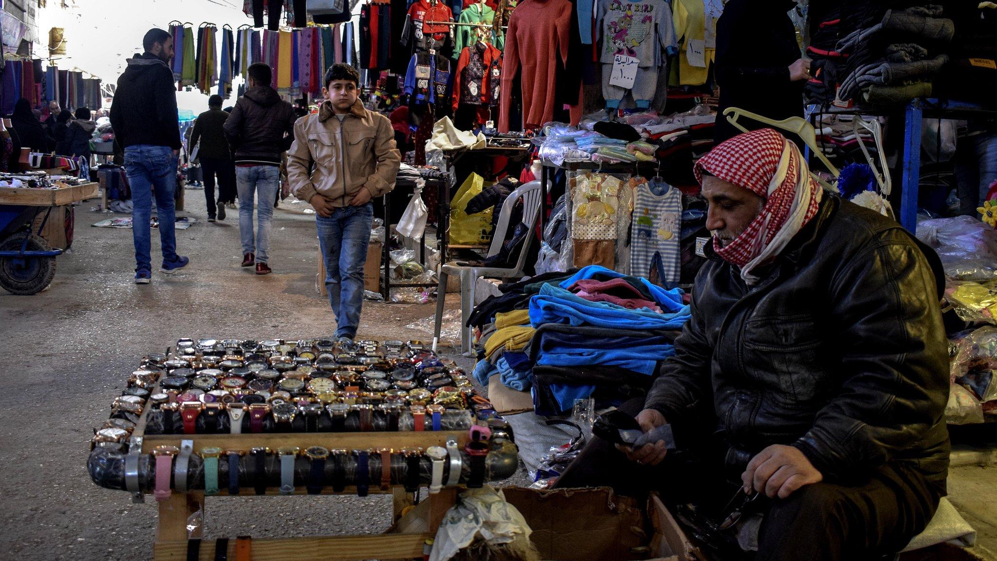 War-weary Syrians in Kurdish-held Manbij wait to learn fate