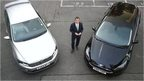 The BBC's Richard Westcott with a VW model (left) and a Ford Focus