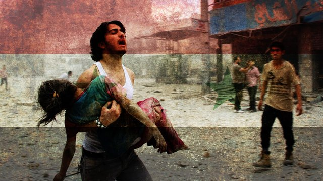 Syrian man carrying wounded child