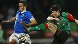 Linfield striker Andrew Waterworth attempts to block a shot by Glentoran opponent Willie Garrett