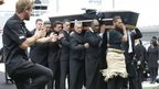 Jonah Lomu's casket is carried out as a haka is performed