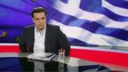 "Greek Prime Minister Alexis Tsipras (R) gives an interview to Greece""s state television ERT on Monday night, in Athens, Greece, 29 June 2015."