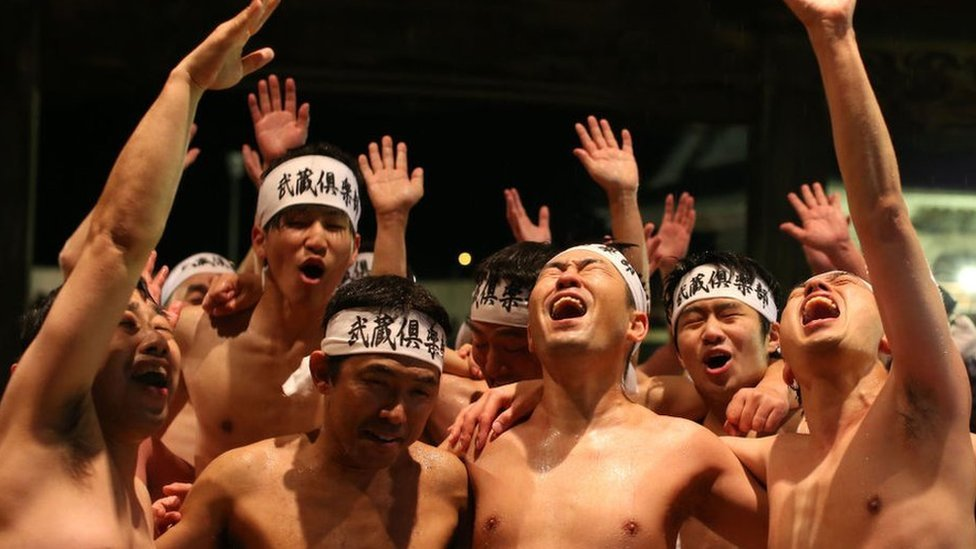 Near-naked men scramble for sticks in Japan