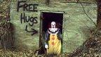 Clown in the woods offering free hugs