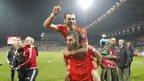 Joe Ledley gives Gareth Bale a celebratory piggyback.