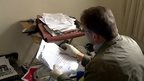 A council officer looks through paperwork