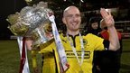 Ryan Catney with the League Cup trophy