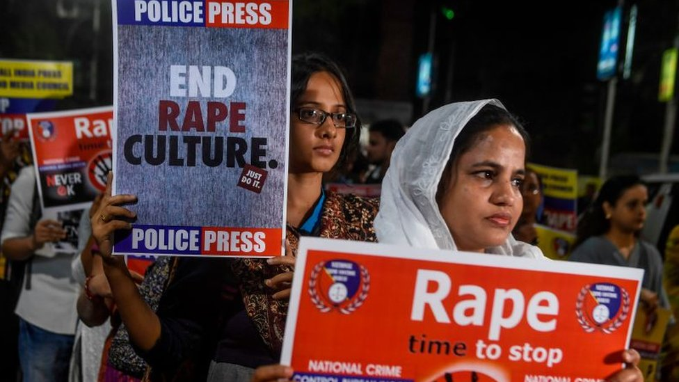 Demonstrators in India hold placards to protest against sexual assaults on women, File photo