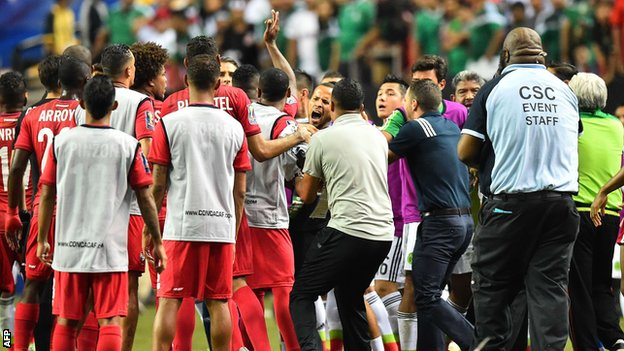 Mexico and Panama players clash