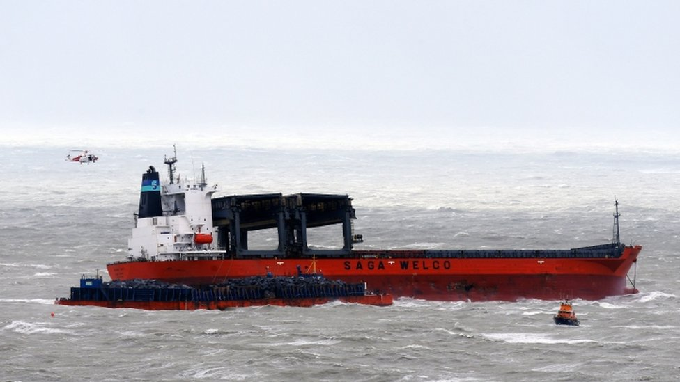 Cargo ship hits barge in Storm Angus