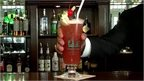 Singapore Sling cocktail is placed on the bar of the Raffles Hotel