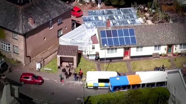 Aerial of police searching former home of a paedophile couple David and Pauline Williams
