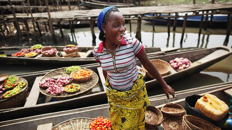 Trader on a boat in Benin
