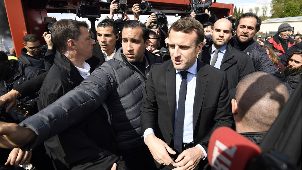 France election: Macron heckled by pro-Le Pen workers